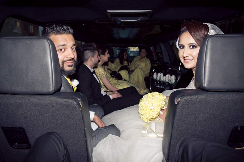 Bride & Groom in the Limo